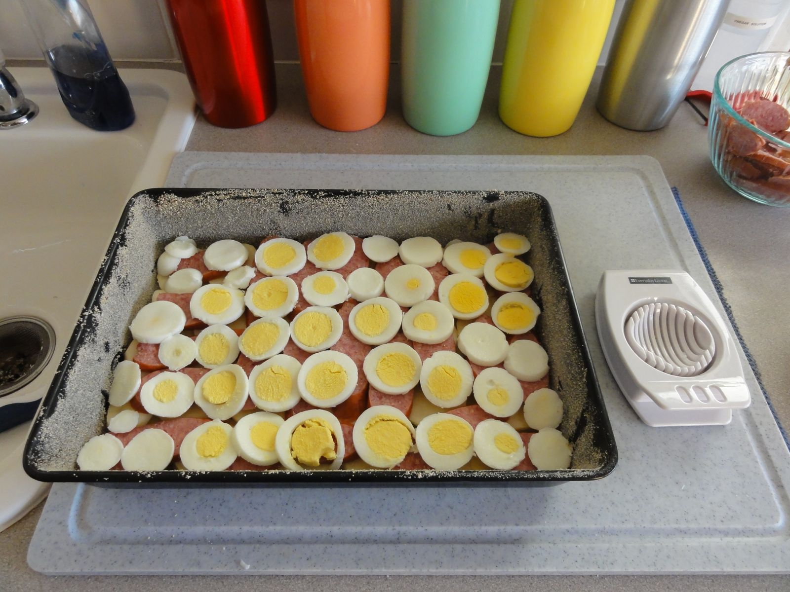 Add sliced eggs, then salt and lightly brush with melted butter.